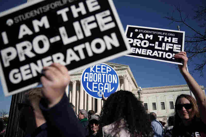 """Anti-abortion rights activists hold signs reading """"I Am The Pro-Life Generation"""" during the 2018 March for Life in January."""