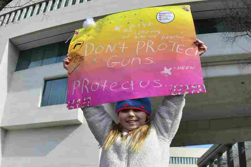 """A little girl holds a placard at the """"March For Our Lives"""" rally in Washington, D.C on March 24."""