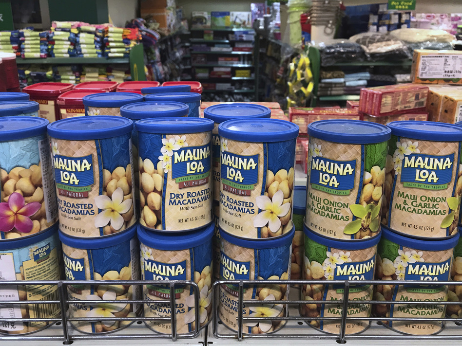 Imported nuts from the United States are displayed for sale at a supermarket in Beijing on Monday. China raised import duties on U.S. pork, fruit and other products Monday. (Andy Wong/AP)