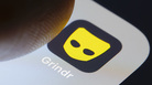 A photo illustration of the Grindr app is displayed on a smartphone in Berlin, Germany, in February.