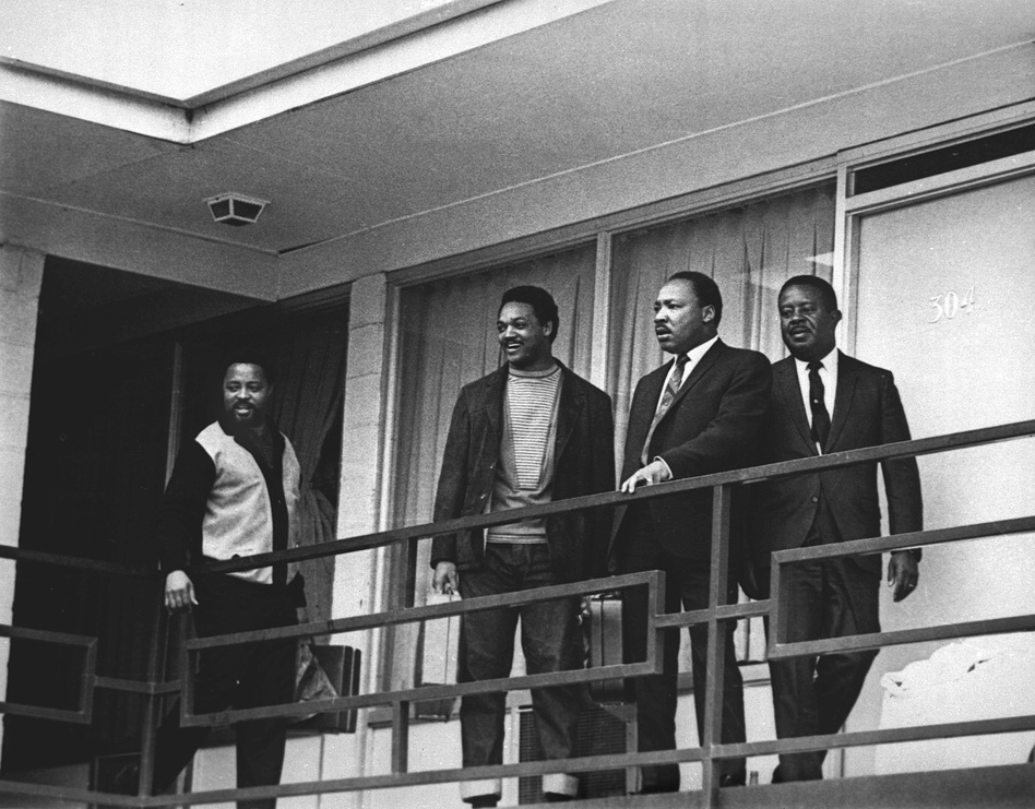 Martin Luther King Jr. stands with fellow civil rights leaders on the balcony of the Lorraine Motel in Memphis, Tenn., on April 3, 1968 — one day before he was assassinated while standing in approximately the same place. From left are Hosea Williams, Jesse Jackson, King and Ralph Abernathy. (Charles Kelly/AP)