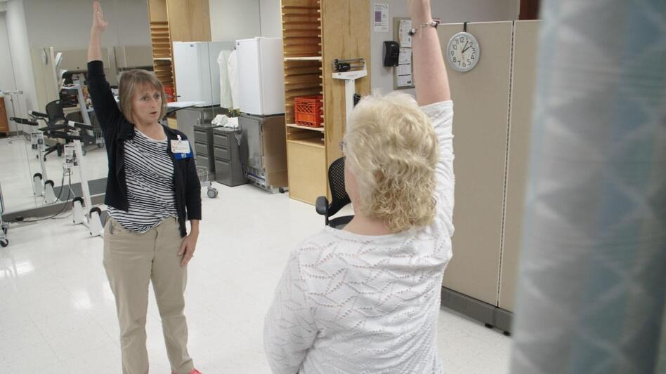 Physical therapist Ingrid Peele coaches Kim Brown through strengthening exercises to help her with her chronic pain, at the OSF Central Illinois Pain Center in Peoria.