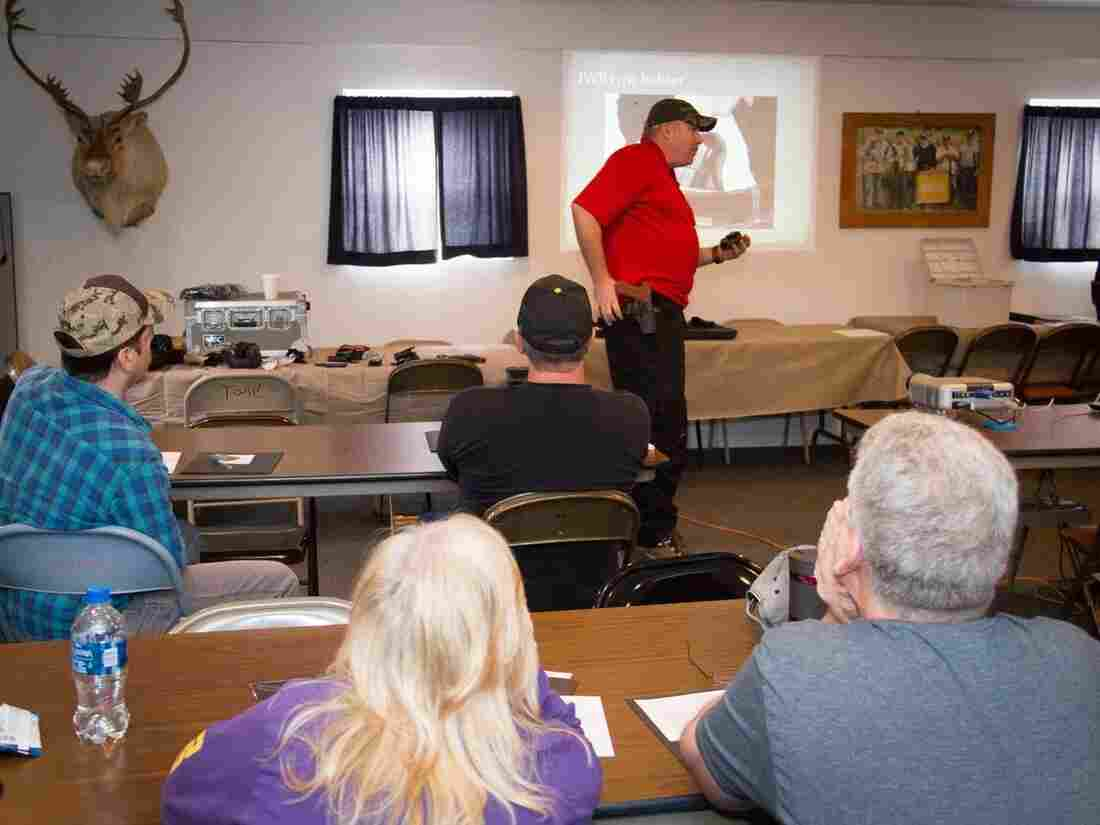 Parishioners of the Lighthouse Mexico Church of God listen as Cory Monroe, a firearms instructor, speaks on how to carry a concealed weapon.