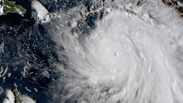 This Monday, Sept. 18, 2017, GOES East satellite image provided by NASA shows the eye of Hurricane Maria as it nears Dominica and before it struck Puerto Rico.