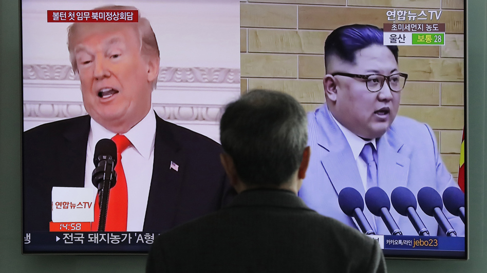 A man watches a TV screen showing archival video of President Trump and North Korean leader Kim Jong Un, during a news program at the Seoul Railway Station in Seoul, South Korea, last month. (Lee Jin-man/AP)