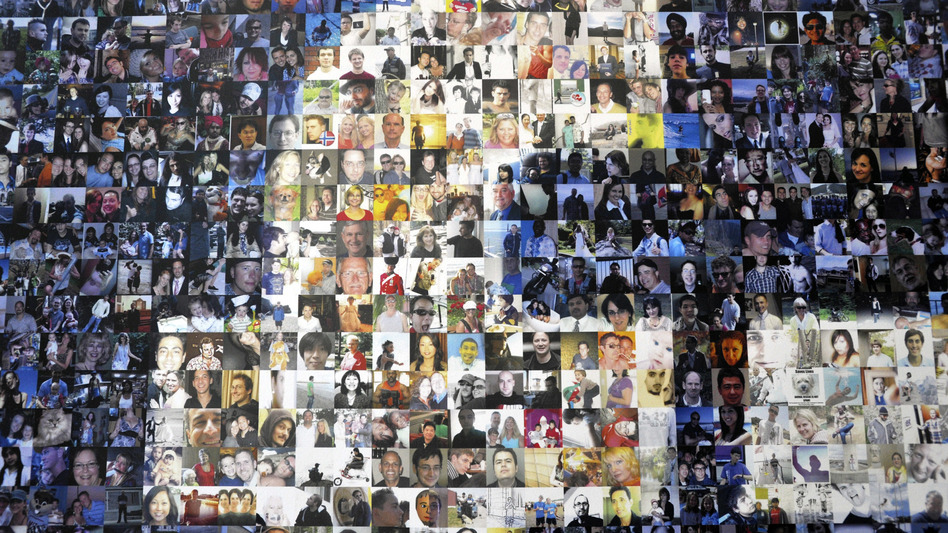 A collage of profile pictures featured on a break room wall at the North Carolina Facebook Data Center in 2012. (Rainier Ehrhardt/Getty Images)