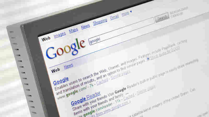 Google search engine page with search results displayed on a computer monitor