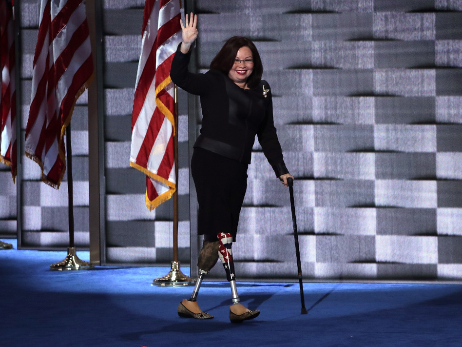 Sen. Tammy Duckworth walks across stage at the Democratic National Convention in 2016. She is the first senator to give birth while serving in office. (Alex Wong/Getty Images)