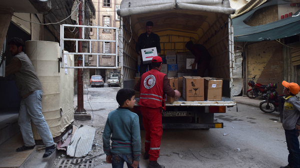 A U.N. convoy carrying aid enters Douma, a besieged town in eastern Ghouta, Syria in March.