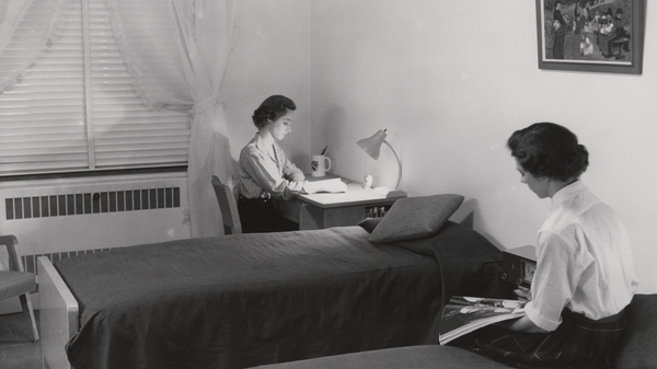 Two roommates in the 1950s study in their shared Duke University dormitory.