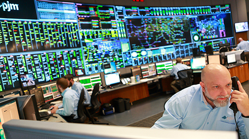 In the control room of PJM Interconnection, employees monitor a power grid that stretches across the Midwest and Mid-Atlantic.