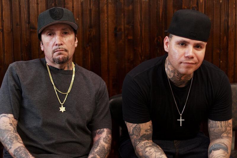 7fba51e3c Freddy Negrete (left) at the Shamrock Social Club where he tattoos  alongside his son, Isaiah. Shereen Marisol Meraji/NPR hide caption