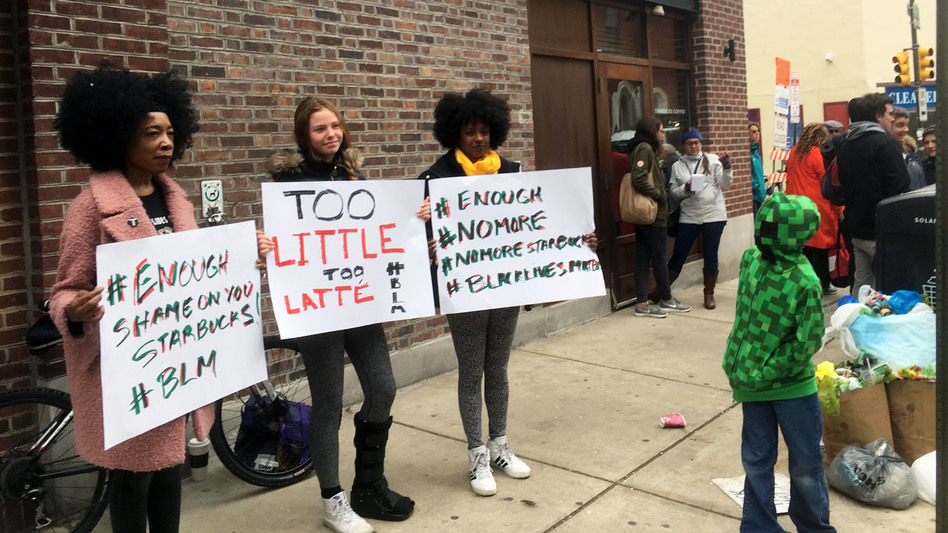 Protesters gather outside a Starbucks in Philadelphia on Sunday, where two black men were arrested Thursday after Starbucks employees called police to say the men were trespassing. (Ron Todt/AP)