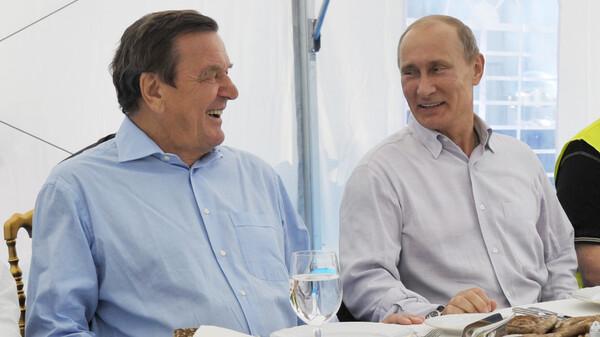 Former German Chancellor Gerhard Schroeder (left) and Russia
