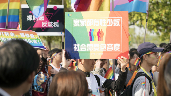 """Days after Weibo announced it would ban homosexual content, an already-planned rally was held in Nanjing, China, to raise awareness of discrimination against homosexuals. This photo from Sunday was released to the AP by the Jiangsu Tongtian Volunteer Group, which said more than 20,000 people took part in the """"Rainbow Marathon"""" event."""