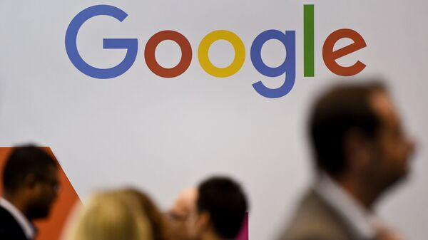 People pass by the Google logo at the Web Summit in Lisbon on Nov. 8. Europe