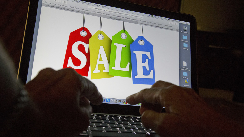 A person in Miami searches the Internet for sales. A case relating to whether all Internet purchases will be subject to sales taxes is heard Tuesday at the U.S. Supreme Court.