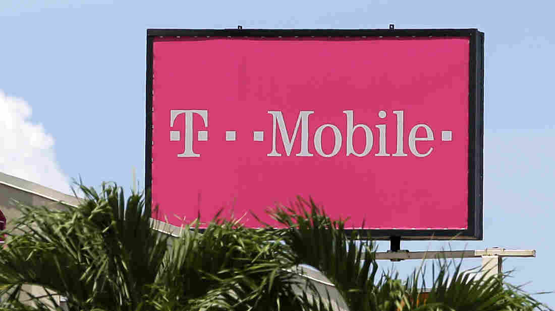 A billboard advertising T-Mobile stands over Hialeah, Fla., last year.