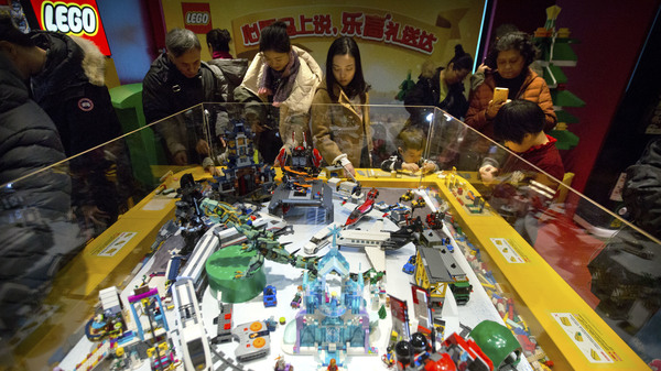 People look at a display of Lego creations at Hamleys toy store during its grand opening in Beijing last year. Exports remain strong for China, but consumption now accounts for 80 percent of the economy