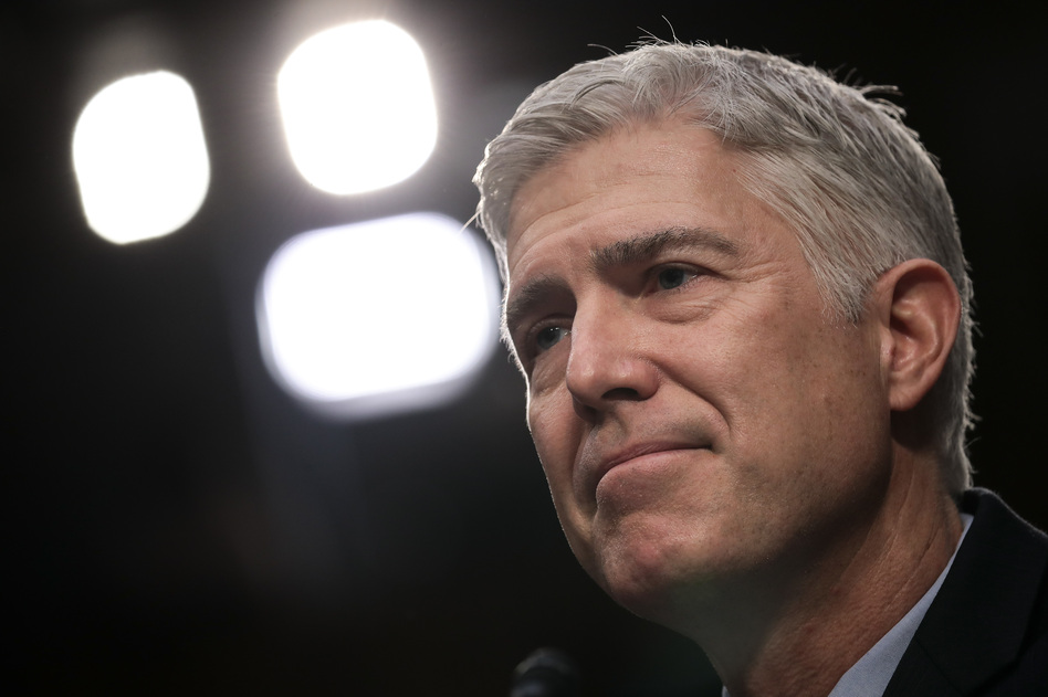 President Trump has hailed his appointment of Neil Gorsuch to the Supreme Court, but Gorsuch sided against the administration Tuesday in an immigration case. (Drew Angerer/Getty Images)