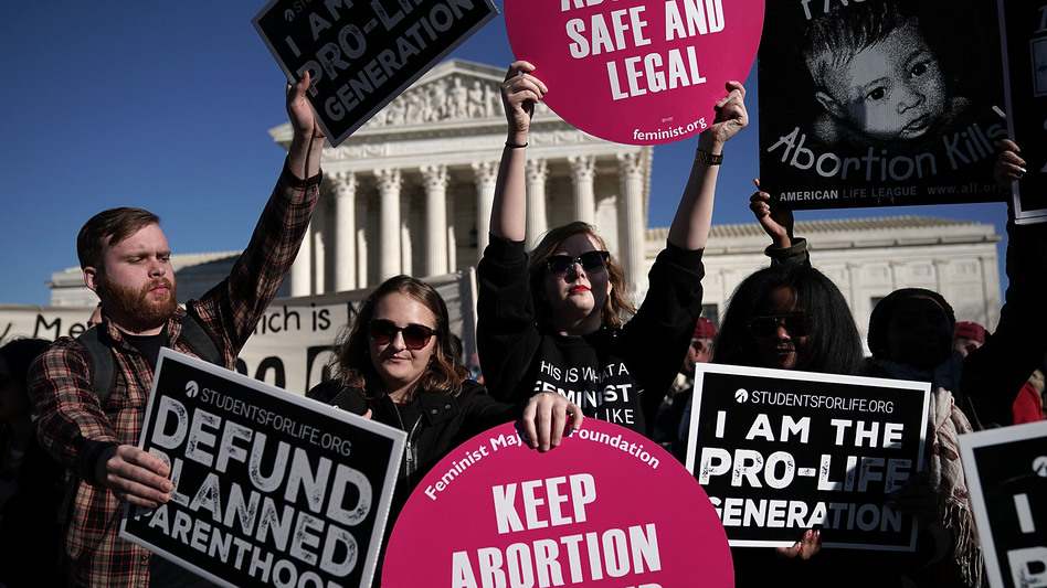 Activists both supporting and opposing abortion rights gathered in front of the the Supreme Court during the March for Life on Jan. 19. (Alex Wong/Getty Images)