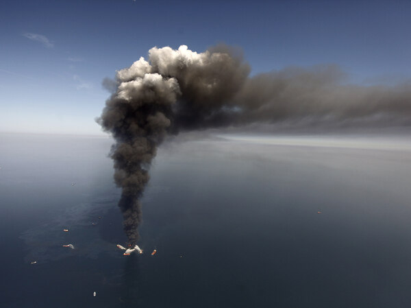 On April 21, 2010, a large plume of smoke rises from BP's Deepwater Horizon offshore oil rig in the Gulf of Mexico.  Eleven men died in the blast.