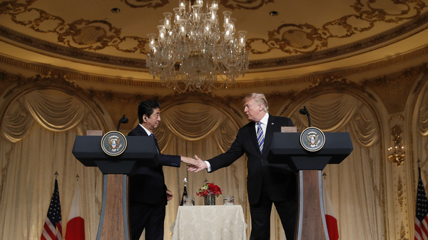 President Trump and Japanese Prime Minister Shinzo Abe shake hands during a news conference at Trump