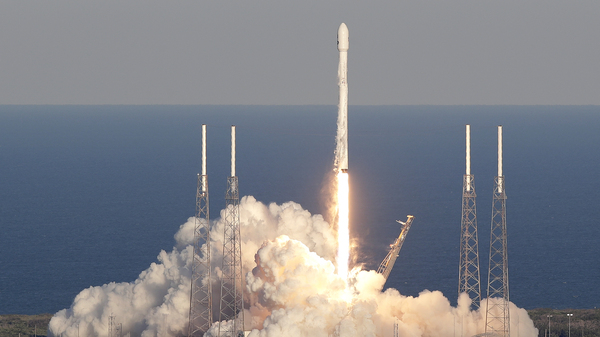 A SpaceX Falcon 9 rocket transporting the TESS satellite lifts off at the Cape Canaveral Air Force Station in Florida on Wednesday. The satellite will scan nearly the entire sky for alien worlds.
