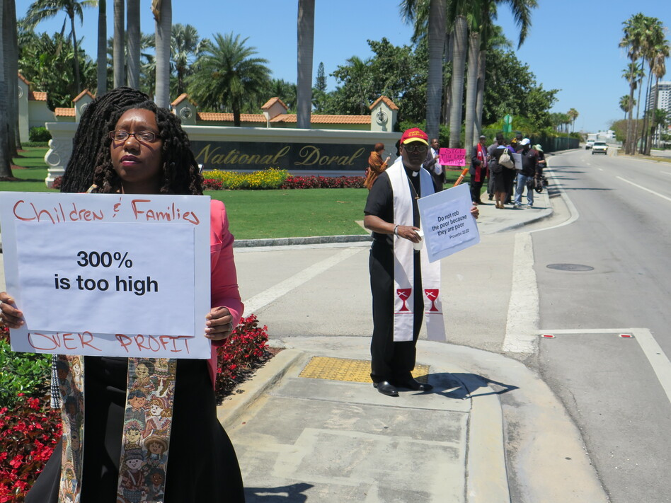 The Rev. Sekinah Hamlin (left) of Greensboro, N.C., and the Rev. Dr. Jack Sullivan Jr., of Findlay, Ohio, were among the faith leaders protesting outside the payday lenders conference near Miami. (Greg Allen/NPR)