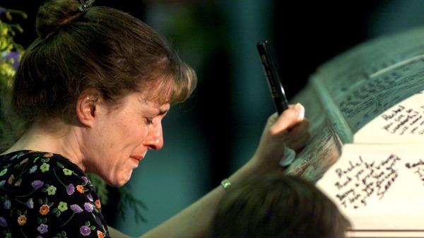 Columbine High School teacher Paula Reed is overcome with grief after signing Rachel Scott