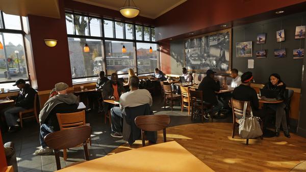 Customers sit in a Starbucks store in Seattle.