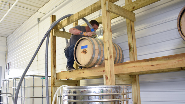 Steve Gagner fills one of the first barrels of bourbon from Danger Close Craft Distilling in St. Albans, Vt.
