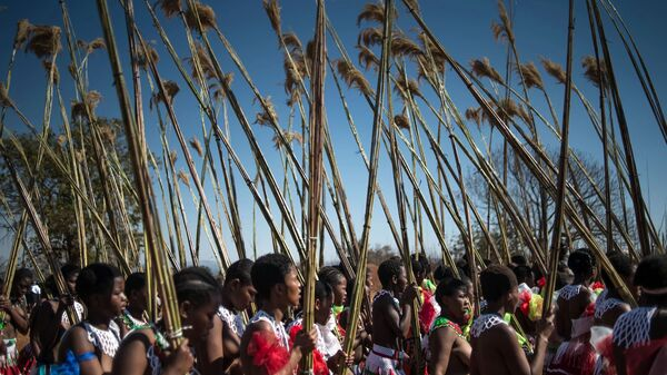 Women march in the 2016 traditional Reed Dance at the royal palace in Lobamba. On Thursday, in celebration of the country