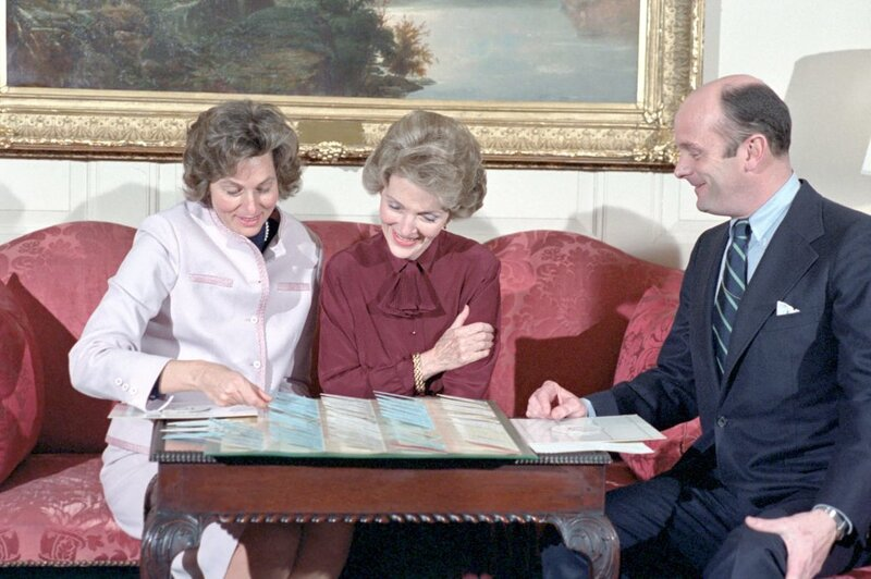 First lady Nancy Reagan reviews plans for the administration's first state dinner in February 1981. (Ronald Reagan Presidential Library and Museum/National Archives and Records Administration)