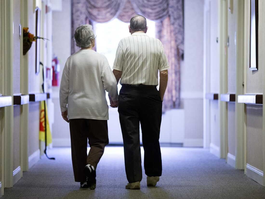 Residents walk the halls at the Easton Home in Easton, Pa.