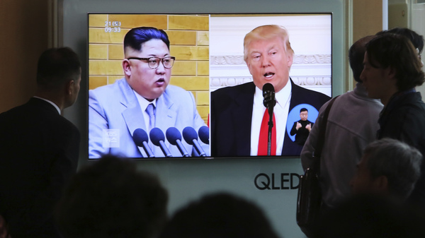 People at Seoul Railway Station in South Korea on Saturday watch a TV screen showing file footage of U.S. President Trump and North Korean leader Kim Jong Un during a news program. North Korea says it has suspended nuclear and long-range missile tests and plans to close its nuclear test site ahead of a new round of negotiations with South Korea and the United States.