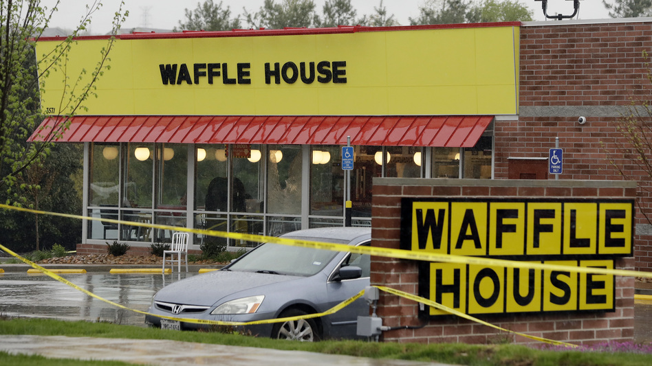 Police tape blocks off a Nashville, Tenn., Waffle House restaurant where at least four people died after a gunman opened fire early Sunday. (Mark Humphrey/AP)