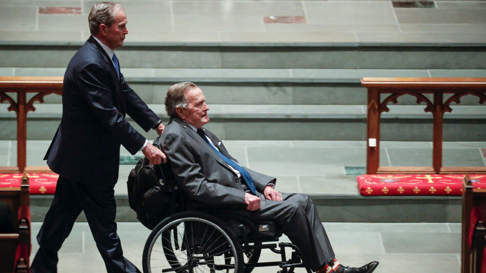 Former President George W. Bush wheels his father, former President George H.W. Bush, into St. Martin's Episcopal Church on Saturday for former first lady Barbara Bush's funeral, in Houston. (Pool/Getty Images)