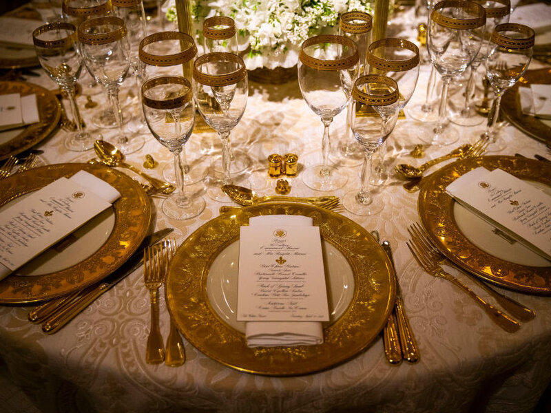 Dinner china is set before President Donald Trump and first lady Melania Trump host French President Emmanuel Macron and his wife, Brigitte Macron, for the first state visit of the Trump administration, in the State Dinning room of the White House, on April 23, 2018 in Washington, DC. (Al Drago/Getty Images)