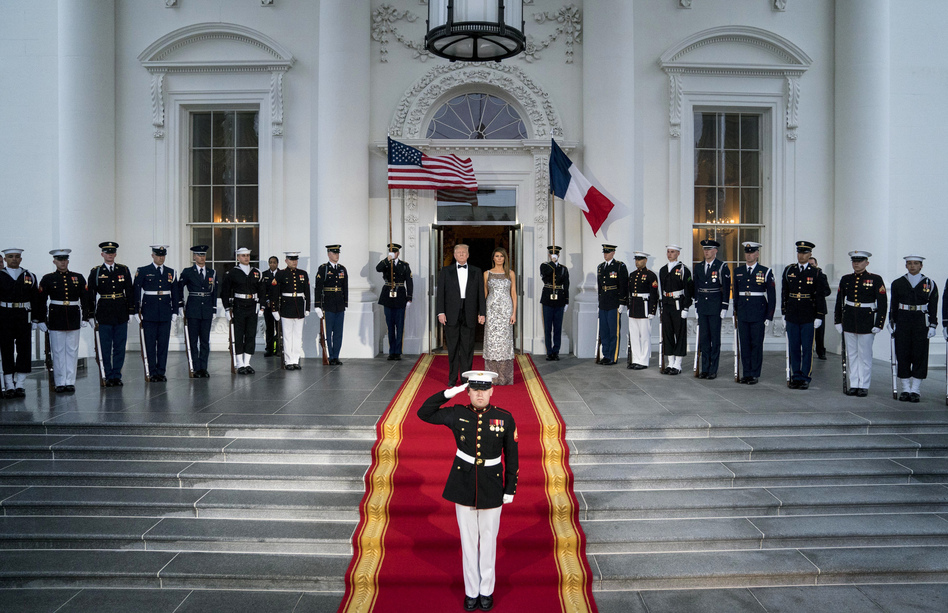 President Trump and first lady Melania Trump prepare to greet French President Emmanuel Macron and his wife, Brigitte Macron, as they arrive for a state dinner at the White House on Tuesday. (Andrew Harnik/AP)