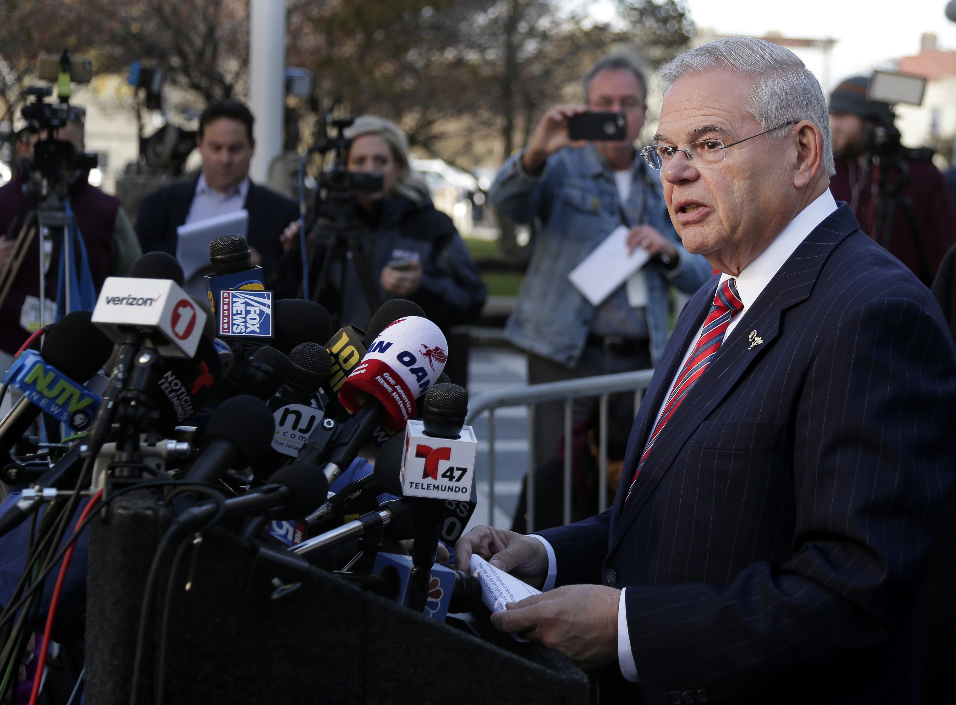 Sen. Bob Menendez, D-N.J., speaks to reporters in front of the courthouse in Newark, N.J., on Nov. 16, 2017. The federal bribery trial of Menendez ended in a mistrial when the jury said it was deadlocked on all charges against him.