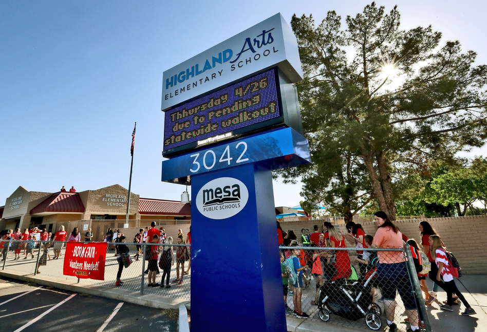 The digital marquee outside Highland Arts Elementary School in Mesa, Ariz., seen at the start of class Wednesday, warns of the effects of the teacher walkout on Thursday. (Matt York/AP)