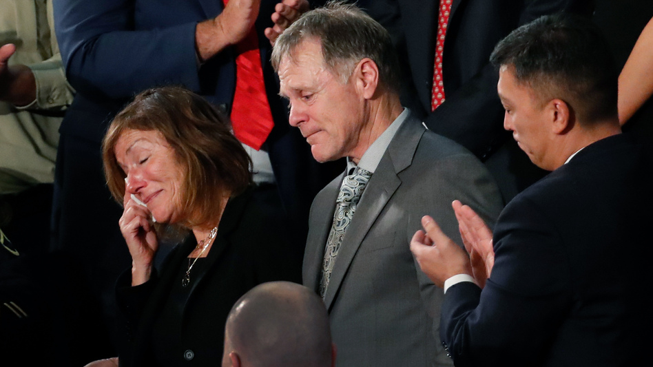 The teary-eyed parents of Otto Warmbier, the American student who died days after being freed from imprisonment in North Korea, react to a standing ovation during President Trump's State of the Union address to a joint session of Congress on Jan 30. The parents filed a wrongful death lawsuit against North Korea on Thursday, saying its government tortured and killed their son. (Pablo Martinez Monsivais/AP)