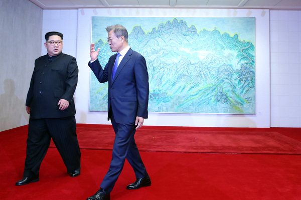 Kim and Moon continue their visit after posing for photos in front of a picture of North Korea's Mount Geumgangsan, which has special significance for all Koreans.