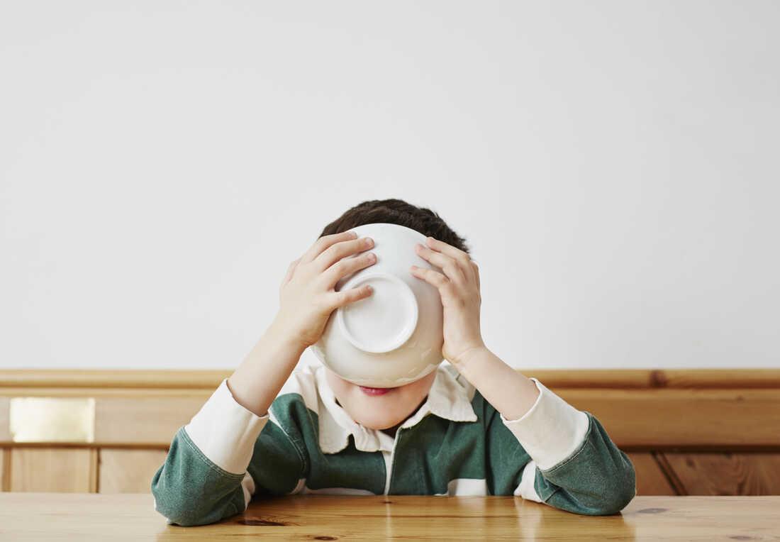 Boy drinking milk from bowl