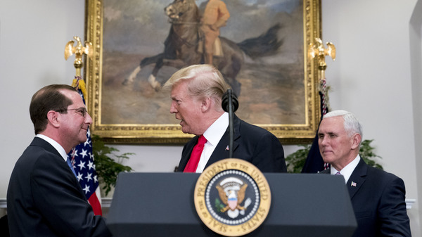 President Trump shakes hands with Health and Human Services Secretary Alex Azar  after he is sworn in by Vice President Pence on Jan. 29. Major reproductive health organizations are voicing concerns about the Trump administration