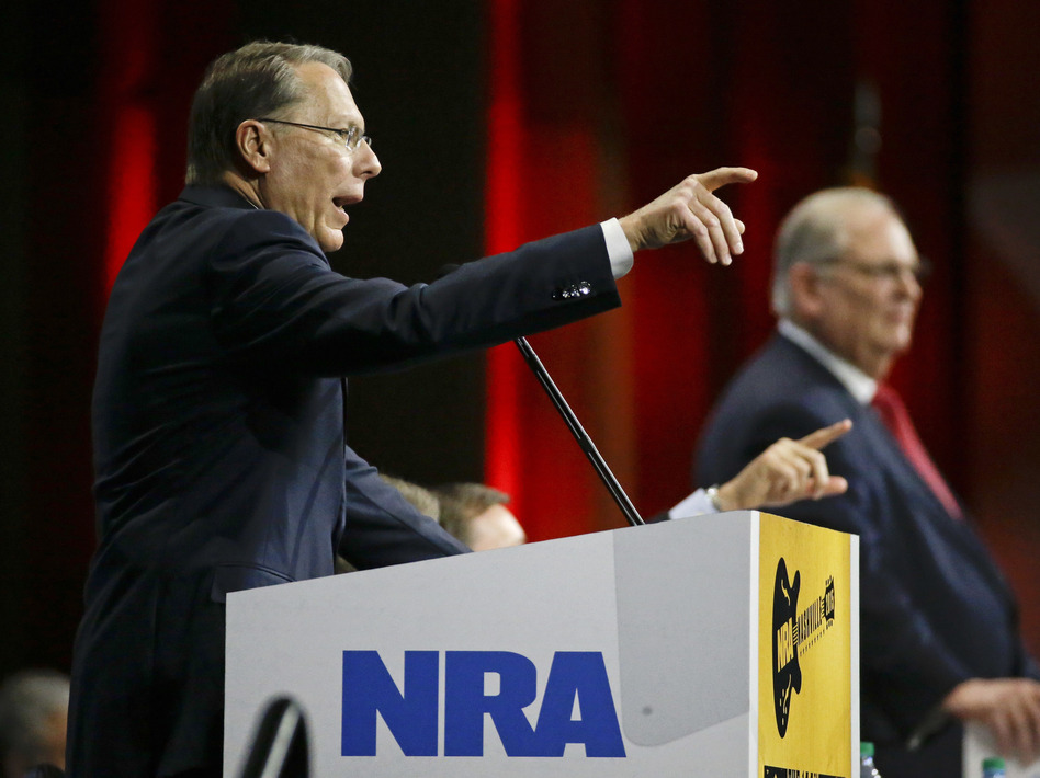 Wayne LaPierre, left, executive vice president of the National Rifle Association, speaks at the NRA convention in 2015. A Russian politician who claims to know President Trump through the group says he saw him at that convention. (Mark Humphrey/AP)