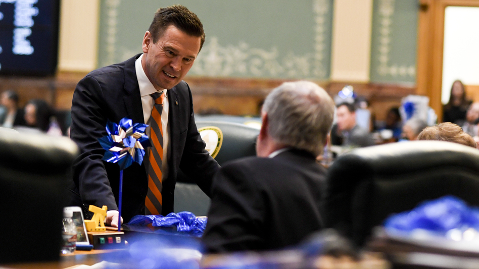 Colorado State Rep. Cole Wist speaks to State Rep. Larry Liston at the Colorado State Capitol on April 25, 2018. Wist, a Republican, is one of the sponsors of a bill that would allow guns to be temporarily taken away from someone who is a significant risk to themselves or to others. (AAron Ontiveroz/Denver Post via Getty Images)
