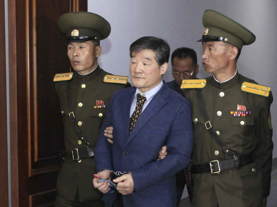 Kim Dong Chul (center) a U.S. citizen detained in North Korea, is escorted from a courtroom after his trial in Pyongyang, North Korea in April 2016. He is one of three Americans currently detained by the Pyongyang regime. (Kim Kwang Hyon/AP)