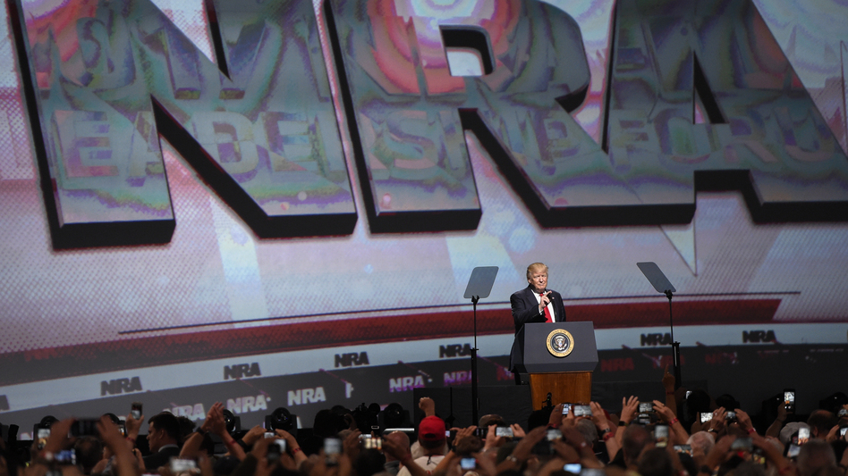 President Trump speaks to the National Rifle Association in 2017 in Atlanta. Despite new political pressure, the president and vice president are both scheduled to speak to the group this year. (Mike Stewart/AP)